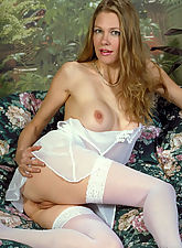 Mature busty blonde Lilli spreads her pussy and ass in a pair of stockings
