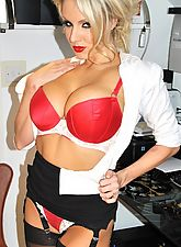 Once Dannii Harwood gets home from a long hard day at the office, she immediately likes to get out her tight skirt and blouse. She then likes to parade round in her red lingerie before stripping down to her sexy nylon stockings