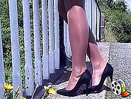 This cheeky brunette goes for a walk outdoors wearing some very sexy nylons