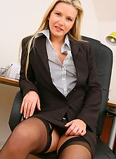 Breathtaking blonde secretary in smart black skirt suit